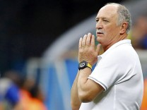 Brazil's coach Luiz Felipe Scolari reacts during their 2014 World Cup third-place playoff against the Netherlands at the Brasilia national stadium in Brasilia