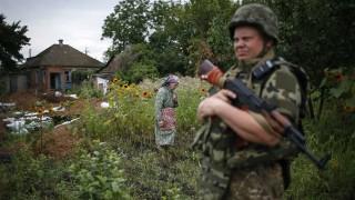 A member of the Ukrainian police special task force 'Kiev-1' patrols in Semenovka