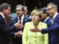 Britain's PM Cameron, Portugal's PM Passos Coelho, Germany's Chancellor Merkel and Finland's PM Stubb attend an EU leaders summit in Brussels