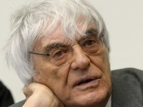 Formula One chief executive Ecclestone waits for another day of his trial at the courthouse in Munich