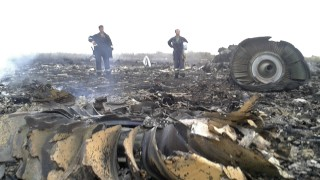 Emergencies Ministry members work at the site of a Malaysia Airlines Boeing 777 plane crash in the settlement of Grabovo in the Donetsk region