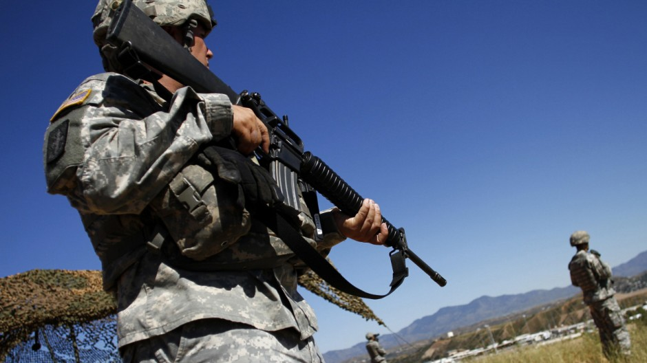 United States National Guard troops patrol along the U.S. and Mexico border in Nogales