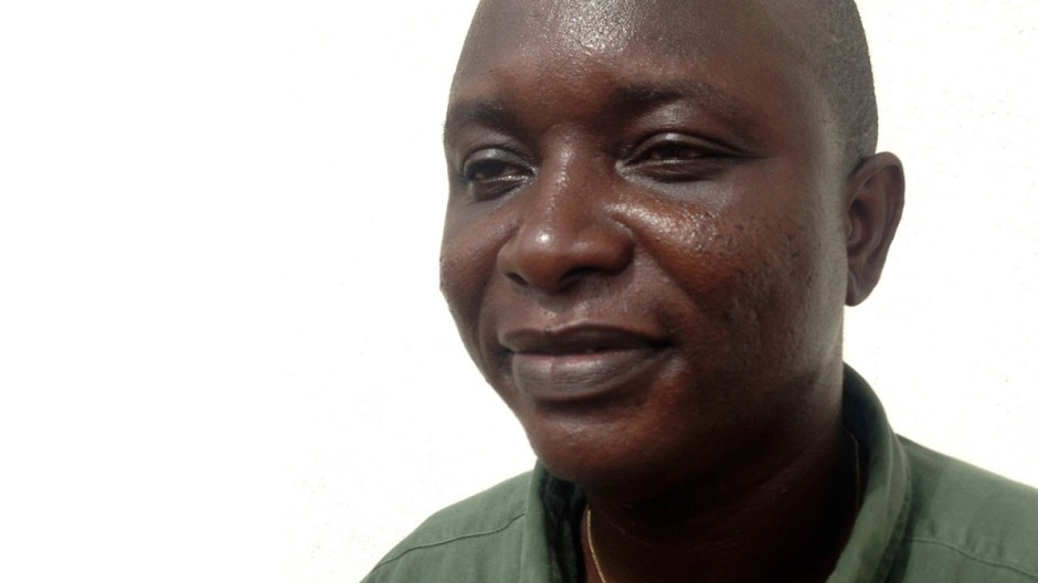 Khan, head doctor fighting the deadly tropical virus Ebola in Sierra Leone, poses in Freetown