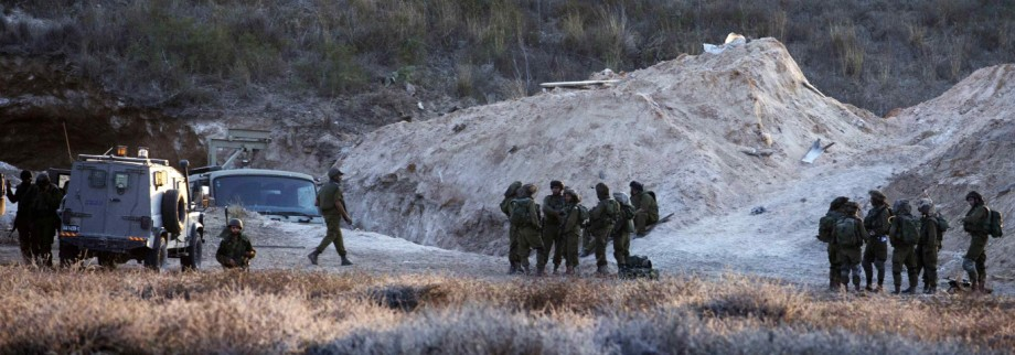 An Israeli truck is seen near a tunnel during an operation to search for tunnels dug by the Palestinian militants, near Kibbutz Nir Am just outside the Gaza Strip