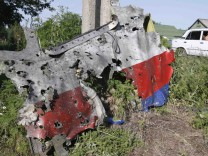 A piece of the wreckage is seen at a crash site of the Malaysia Airlines Flight MH17 in the village of Petropavlivka (Petropavlovka), Donetsk region