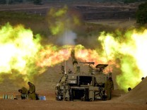 Israeli artillery fires from Israel into the Gaza Strip just befo