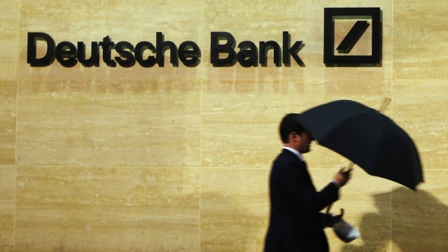 A man walks past Deutsche Bank offices in London