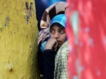 Palestinians take refuge at a UN school from Israeli airstrikes i