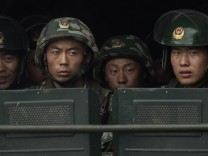 China Steps Up Security Following Xinjiang Unrest