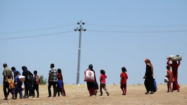 Refugees Fleeing ISIS Offensive Pour Into Kurdistan
