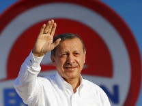 Turkey's Prime Minister and presidential candidate Erdogan greets his supporters during an election rally in Istanbul