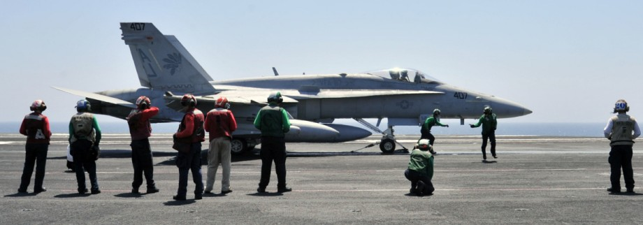 Handout photo shows sailors making final inspections on an F/A-18C Hornet on the flight deck of the aircraft carrier USS George H.W. Bush in the Gulf
