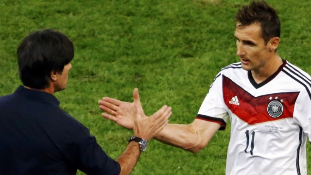 Germany's Miroslav Klose shakes hands with coach Joachim Loew as he leaves the pitch during their 2014 World Cup final against Argentina at the Maracana stadium in Rio de Janeiro