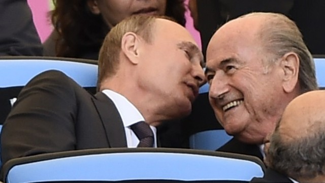 Russian President Putin speaks to FIFA President Blatter during the 2014 World Cup final between Germany and Argentina in Rio de Janeiro