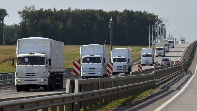 A Russian convoy of trucks carrying humanitarian aid for Ukraine drives along a road near the city of Yelets