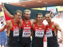 Reus, Jakubczyk, Knipphals and Kosenkow of Germany celebrate their second place in the men's 4 x 100 metres final during the European Athletics Championships at the Letzigrund Stadium in Zurich