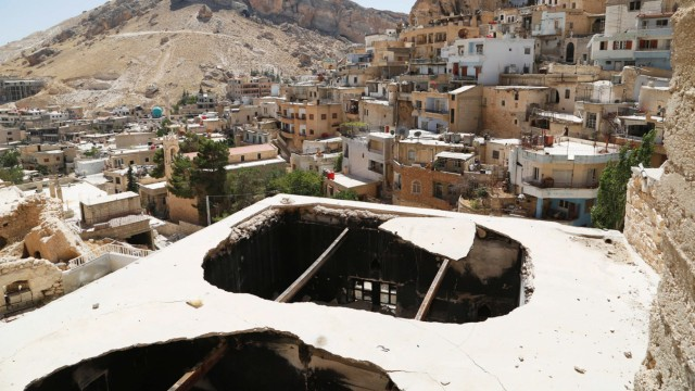 A general view shows damage in the city of Maaloula