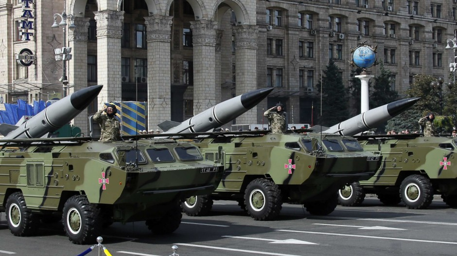Soldiers salute as they parade on Tochka-U tactical rocket complexes during Ukraine's Independence Day military parade, in the center of Kiev