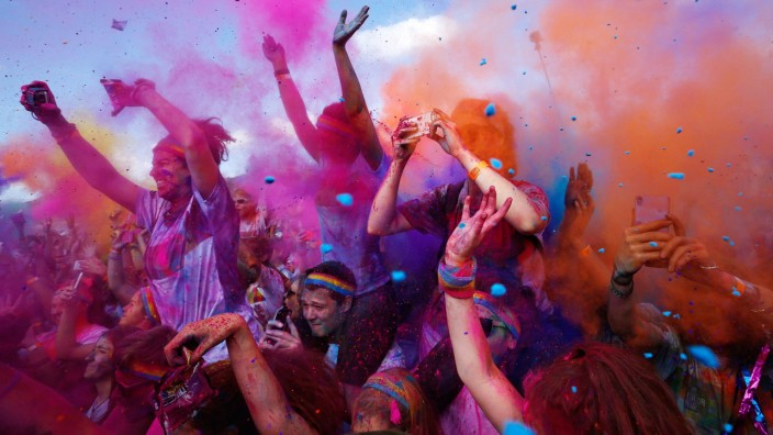 Multi-coloured dyes are thrown in the air by participants during Sydney's Color Run