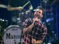 Adam Levine of pop rock band Maroon 5 performs during the band's album release party for 'V' at the iHeartRadio theatre in Burbank