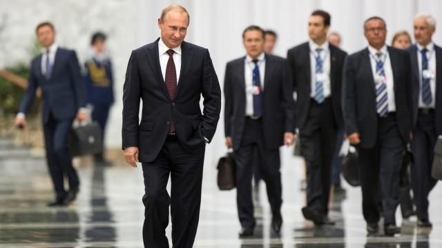 Russian President Putin arrives to speak to the media after talks with Ukrainian President Poroshenko in Minsk, Belarus
