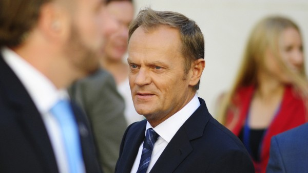 Poland's PM Tusk walks outside the parliament in Warsaw