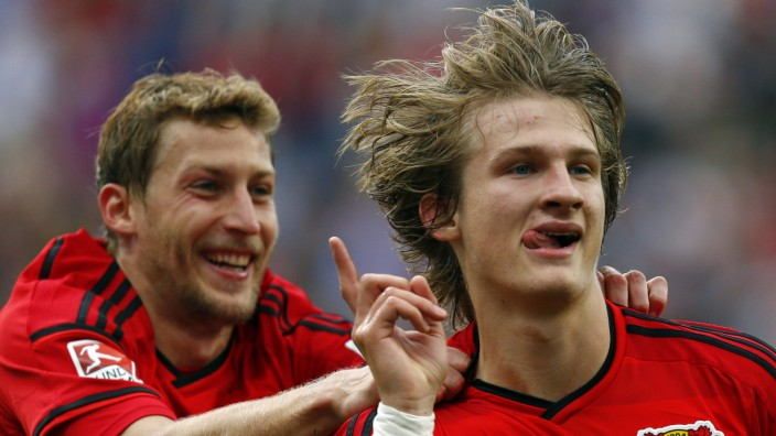 Bayer Leverkusen's Kiessling and Jedvaj celebrate Jedvaj's goal against Hertha BSC Berlin during their German first division Bundesliga soccer match in Leverkusen