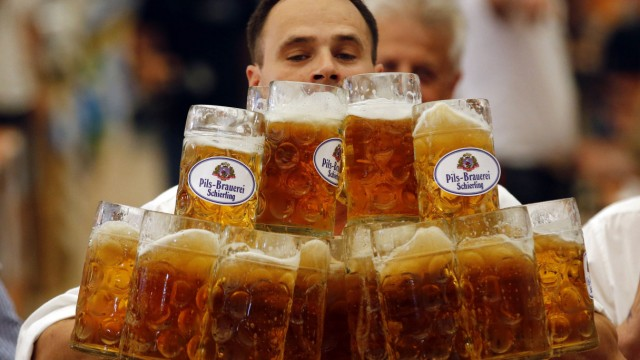 Struempfl competes to set a new world record in carrying one liter beer mugs in Abensberg