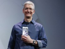 Apple CEO Tim Cook shows the iPhone 6 Plus during an Apple event at the Flint Center in Cupertino