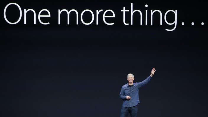 Apple CEO Tim Cook speaks on stage during an Apple event at the Flint Center in Cupertino
