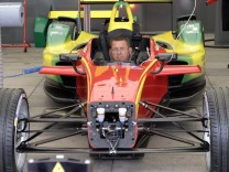 An engineer checks in an Audi Sport ABT car as he prepares for the upcoming Formula E Championship race in Beijing