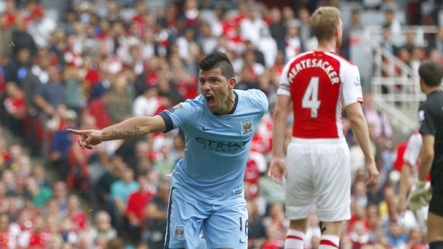Manchester City's Aguero celebrates after scoring a goal against Arsenal during their English Premier League soccer match at the Emirates stadium in London