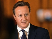 Britain's Prime Minister David Cameron makes a statement to the media following the killing of aid worker David Haines
