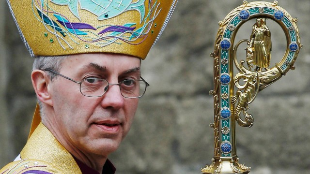The new Archbishop of Canterbury Justin Welby leaves after his enthronement ceremony at Canterbury Cathedral, in Canterbury, southern England