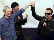 Apple CEO Tim Cook, Bono, U2, iPhone