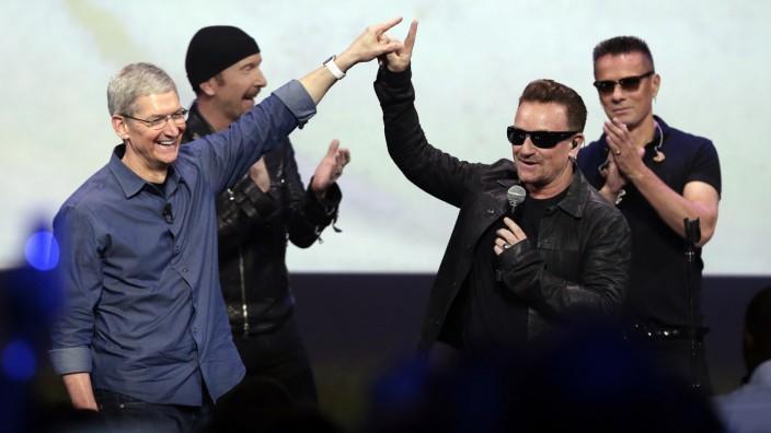 Apple CEO Tim Cook, Bono, U2, iPhone