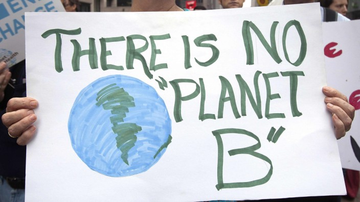 A protester carries a sign during the 'People's Climate March' in the Manhattan borough of New York
