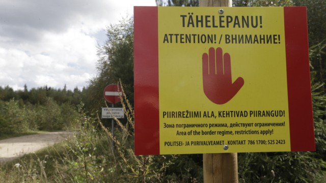 A warning sign is pictured near the Estonian-Russian border, where, according to Estonia's officials, its security officer was abducted near the village of Miikse