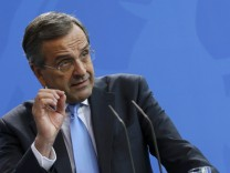 Greek Prime Minister Samaras addresses a joint news conference in Berlin