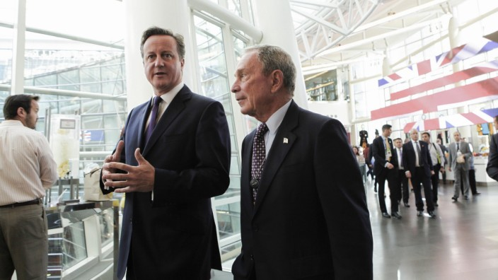 British Prime Minister David Cameron speaks with Michael Bloomberg at the company's headquarters in New York