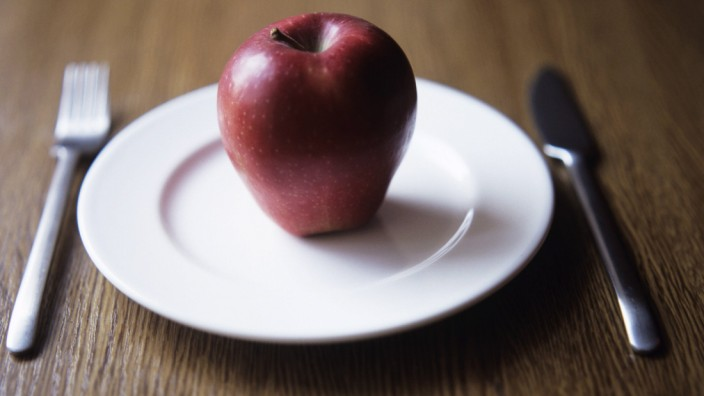 Apple on plate Apple on a plate This image could be used to depict healthy eating or dieting PUBLI