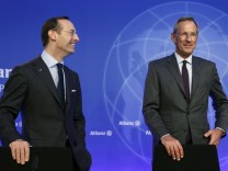 Diekmann, CEO of insurer Allianz and Baete pose before company's annual news conference in Munich