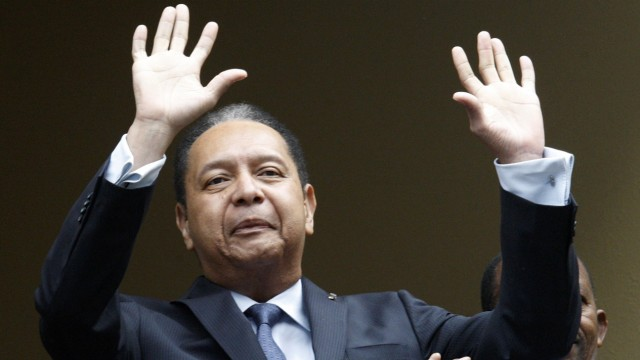 File picture of former Haitian dictator Jean-Claude 'Baby Doc' Duvalier greeting the crowd from his hotel in Port-au-Prince