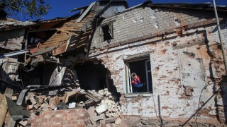 Ukraine and separatists claim gains in Donetsk airport battle