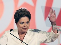 Brazil's President and Workers' Party (PT) presidential candidate Dilma Rousseff gestures during a news conference after voting in the first round of election in Brasilia