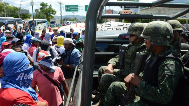 Teachers and relatives of the 43 missing Mexican youths protest