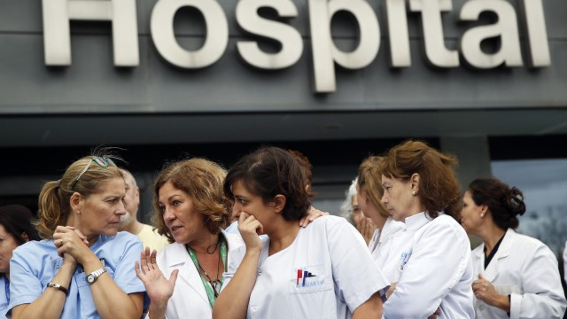 Health workers attend a protest outside La Paz Hospital calling for Spain's Health Minister Ana Mato to resign after a Spanish nurse contracted Ebola, in Madrid