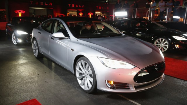 New all-wheel-drive versions of the Tesla Model S car are lined up for test drives in Hawthorne, California