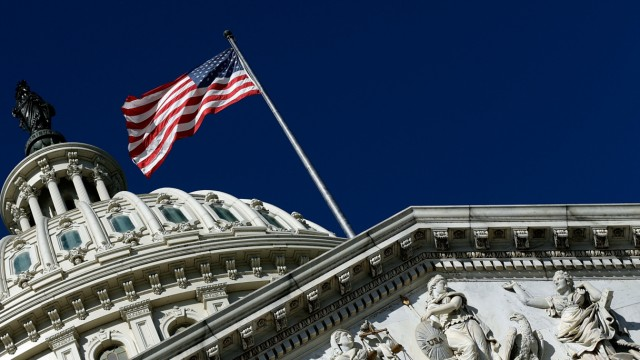Congress Gridlocked Over Continuing Resolution Legislation WASHINGTON, DC - SEPTEMBER 29: An American flag waves outside the United States Capitol building as Congress remains