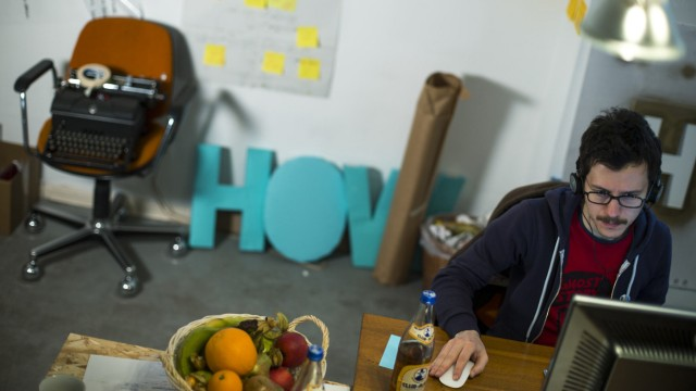 Contini of Italy works in the office of the HowDo start-up at the Wostel co-working space in Berlin